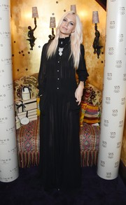 Poppy Delevingne attended the Links of London anniversary event all covered up in a long-sleeve, high-neck black maxi dress. Thanks to that sheer fabric, she still managed to look oh-so-sultry.