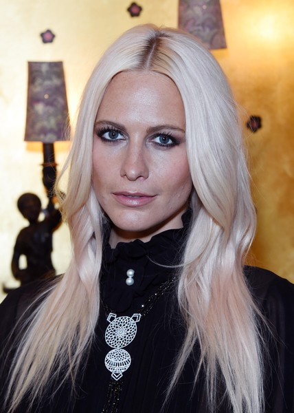 Poppy Delevingne sported her usual center-parted style when she attended the Links of London anniversary event.