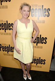Virginia Madsen looked ready for summer in this pastel yellow belted frock.