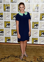 Willow Shields chose a mod-style navy dress with a wide Peter Pan collar in sea foam.