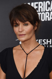 Helena Christensen swept her hair up into a messy 'do for the New York screening of 'American Pastoral.'