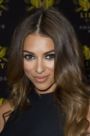 Georgia Salpa showed off her lovely locks with this center-parted wavy 'do.
