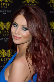 Amy Childs chose a long and voluminous wavy style for her deep purple-red hair.