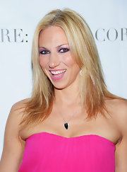 Debbie Gibson paired purple tones of shadow to create her bold look for a 'Celebrity Apprentice' panel discussion.
