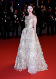 Mackenzie Foy glided down the 'Little Prince' red carpet in a gorgeous gold strapless gown by Oscar de la Renta.