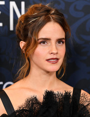 Emma Watson looked romantic wearing this loose bun with wavy tendrils at the world premiere of 'Little Women.'