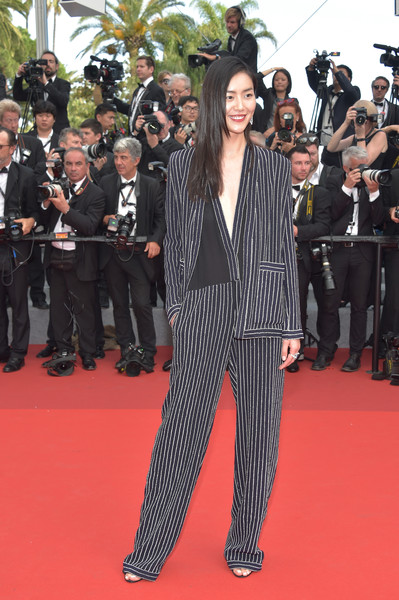 Liu Wen Pantsuit [flooring,carpet,fashion,red carpet,event,suit,costume,product,premiere,red carpet arrivals,liu wen,cannes,france,cannes film festival,screening,palais des festivals]