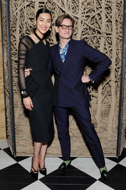Liu Wen donned an edgy-chic black Balenciaga crop-top, featuring a geometric neckline and sheer sleeves, for the Met Gala private cocktail party.