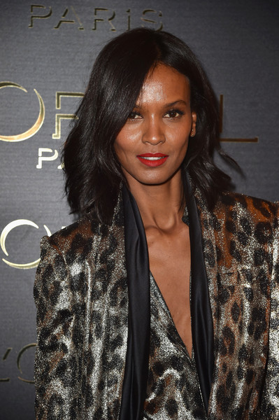 Liya Kebede Medium Wavy Cut [hair,hairstyle,long hair,black hair,fashion,lip,brown hair,layered hair,fashion design,outerwear,liya kebede,photocall - paris fashion week womenswear spring,part,paris,france,loreal,obsession party,gold obsession party]