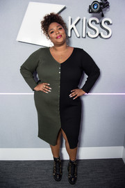 Lizzo styled her look with a pair of star-embellished lace-up boots.