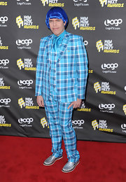 Perez Hilton's ensemble at the 2010 NewNowNext Awards, consisting of a blue plaid suit, metallic silver loafers, and a comical wig, was a sensory overload!