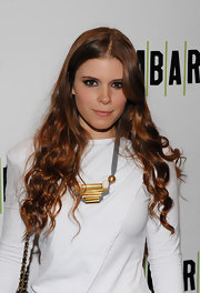 Kate Mara paired her simple yet chic dress with an architectural bronze necklace.