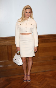 For her arm candy, Pixie Lott kept it classic with a white mini tote by Dolce & Gabbana.