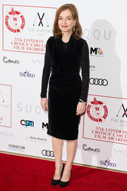 Isabelle Huppert made an elegant choice with this ruched velvet LBD for the London Critics' Circle Film Awards.