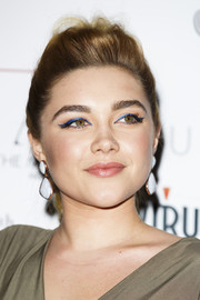 Florence Pugh sealed off her look with a pair of white and gold dangle earrings.