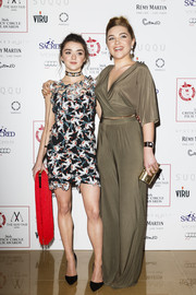 Florence Pugh paired her outfit with a metallic gold clutch.