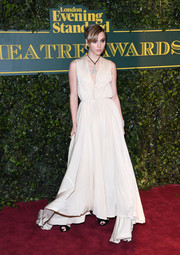 Suki Waterhouse chose a vintage ivory gown from Vestiaire Collective for her London Evening Standard Theatre Awards look.