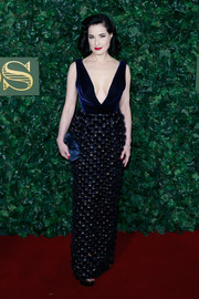 Dita Von Teese looked flawless, as always, at the London Evening Standard Theatre Awards in a navy Ralph & Russo Couture gown boasting a velvet bodice, a plunging neckline, and an ornately embellished skirt.