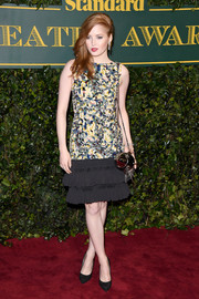 Ellie Bamber chose a Chanel Couture cocktail dress with a patchwork tweed bodice and a ruffle hem for the London Evening Standard Theatre Awards.