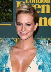 Poppy Delevingne styled her hair into a punky pompadour for the London Evening Standard Theatre Awards.