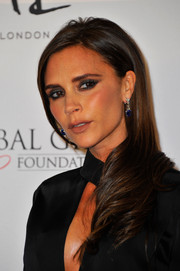 Victoria Beckham left her hair loose with a side part and feathered ends when she attended the London Global Gift Gala.