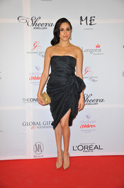 Meghan Markle chose a draped black strapless dress for a classy red carpet look during the London Global Gift Gala.