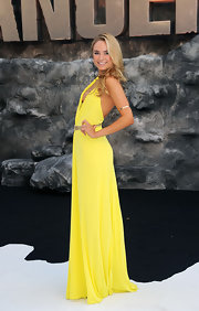 Kimberley's sunshine yellow V-neck dress draped over her frame in an effortless fashion.