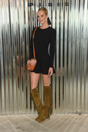 Poppy Delevingne styled her LBD with a pair of fringed olive-green boots.