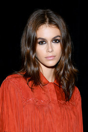 Kaia Gerber walked the Longchamp Spring 2019 show wearing this center-parted wavy hairstyle.