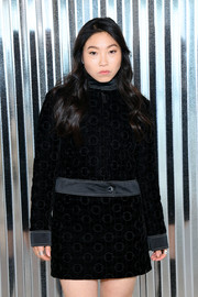 Awkwafina bundled up in a cropped velvet jacket by Longchamp for the brand's Spring 2019 show.