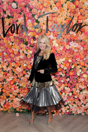 Christie Brinkley paired a black velvet jacket with a pleated metallic dress for the Lord & Taylor Garden City grand reopening.
