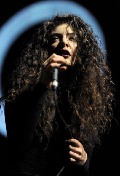 Lorde Long Curls [performance,singing,singer,microphone,performing arts,music artist,music,event,long hair,musician,los angeles,california,the shrine auditorium,kroq almost acoustic christmas,singer lorde]