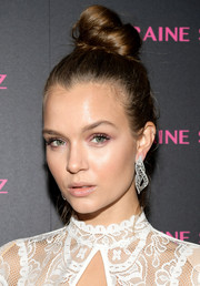 Josephine Skriver styled her hair into a trendy top knot for the launch of the Eye Bangle.