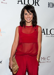 Constance Zimmer looked stylish at the LA Confidential pre-Emmy celebration in her all-red sheer blouse and pants combo.