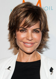 Lisa Rinna stuck to her trademark layered razor cut when she attended the LA Confidential pre-Emmy celebration.