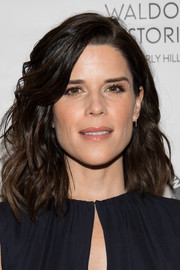 Neve Campbell showed off stylish feathered waves at the Los Angeles Confidential Women of Influence tea.