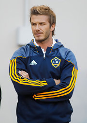 David Beckham wore his hair in a medium length side-part.