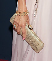 Eva topped her chiffon clutch off with a gold bracelet.