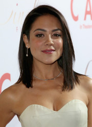 Camille Guaty looked simply fab wearing this straight, side-parted hairstyle at the 'Cake' premiere.
