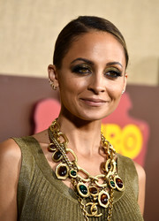 Nicole Richie spiced up her look with a ton of gold chain necklaces.