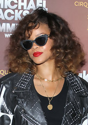 Rihanna wore a rich ruby red lipstick when she attended the opening of Cirque du Soleil's 'Michael Jackson The Immortal World Tour.'