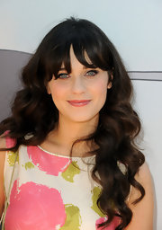 Zooey Deschanel was spotted at the 'Winnie the Pooh' premiere with pretty pink lips that matched her Kate Spade dress.