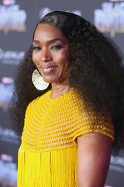 Angela Bassett sported long natural curls at the world premiere of 'Black Panther.'