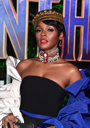 Janelle Monae continued the flamboyant vibe with a statement beaded choker by Erickson Beamon.