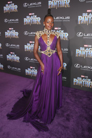 Lupita Nyong'o made an unforgettable entrance in a purple Atelier Versace gown with an ornately embellished harness accent at the world premiere of 'Black Panther.'