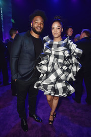Tessa Thompson teamed her dress with black ankle-strap peep-toes.