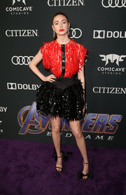 Karen Gillan styled her look with mismatched bow sandals by Jimmy Choo. Cute!