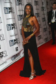 Kelsey Scott was all glammed up in gold gladiator heels and an evening dress with a studded bodice during the New York Film Festival.