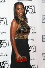Kelsey Scott sparkled on the NYFF red carpet with this gold box clutch and studded dress combo.