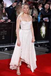 Sienna Miller kept it breezy yet stylish in a lacy, handkerchief-hem corset dress by Alexander McQueen at the UK premiere of 'The Lost City of Z.'